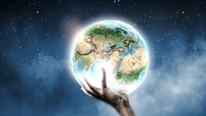 earth-globe-in-hand-4k-wallpaper-768x432